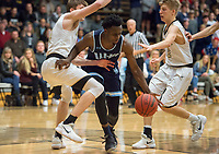 NWA Democrat-Gazette/CHARLIE KAIJO Springdale Har-Ber High School Austin Garrett (1) dribbles past Bentonville High School Michael Shanks (11) and forward Colton Simmons (2) during a basketball game on Friday, January 12, 2018 at Bentonville High School in Bentonville.