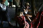Cyclone Nargis survivors in the village of Kamingo, at the Irrawaddy Division, May 10, 2008. Despairing survivors in Myanmar awaited emergency relief on Friday, a week after 100,000 people were feared killed as the cyclone roared across the farms and villages of the low-lying Irrawaddy delta region. The storm is the most devastating one to hit Asia since 1991, when 143,000 people were killed in neighboring Bangladesh. Photo by Eyal Warshavsky  *** Local Caption *** ëì äæëåéåú ùîåøåú ìàéì åøùáñ÷é àéï ìòùåú áúîåðåú ùéîåù ììà àéùåø