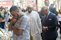 The Prince of Wales visits flowers tribute and has a walkabout in Finsbury Park flanked by the Iman Mohammed Mahmoud of the Muslim Welfare House. <br /> CAP/CAM<br /> &copy;Andre Camara/Capital Pictures /MediaPunch ***NORTH AND SOUTH AMERICAS ONLY***