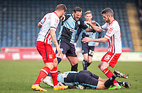 Luke O'Nien of Wycombe Wanderers goes over on the ball as player fight for it during the Sky Bet League 2 match between Wycombe Wanderers and Stevenage at Adams Park, High Wycombe, England on 12 March 2016. Photo by Andy Rowland/PRiME Media Images.