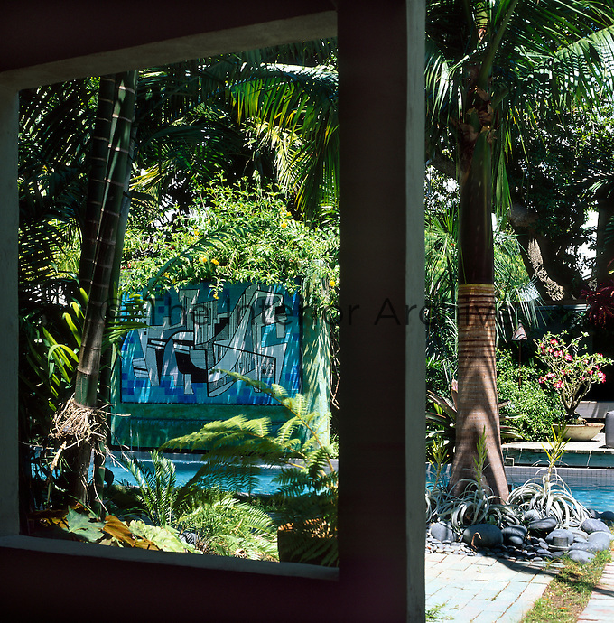 View from house verhanda looking towards pool with tiled panel by  Brazilian landscape designer, Roberto Burle Marx