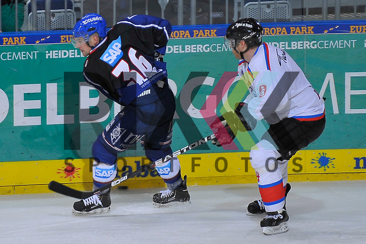 Mannheims Yannic Seidenberg (Nr.36) gegen Nuernbergs James Pollock (Nr.8)  beim Spiel in der DEL, Adler Mannheim - Nuernberg Ice Tigers.<br /> <br /> Foto &copy; Ice-Hockey-Picture-24 *** Foto ist honorarpflichtig! *** Auf Anfrage in hoeherer Qualitaet/Aufloesung. Belegexemplar erbeten. Veroeffentlichung ausschliesslich fuer journalistisch-publizistische Zwecke. For editorial use only.