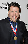 John Travolta arriving at the 11th Annual Living Legends of Aviation Awards, held at The Beverly Hilton Hotel