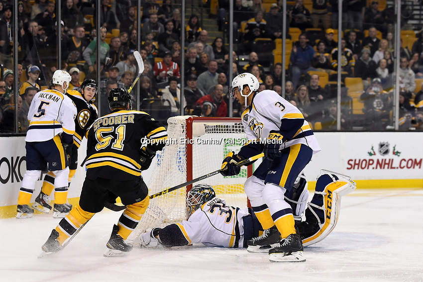 Monday, December 7, 2015: Nashville Predators goalie Carter Hutton (30) dives to cover a puck from Boston Bruins center Ryan Spooner (51) during the National Hockey League game between the Nashville Predators and the Boston Bruins held at TD Garden, in Boston, Massachusetts. The Predators defeat the Bruins 3-2 in regulation time. Eric Canha/CSM