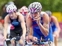 07 AUG 2012 - LONDON, GBR - Ivan Vasiliev (RUS) of Russia puts on his sunglasses during the bike at the men's London 2012 Olympic Games Triathlon in Hyde Park, London, Great Britain .(PHOTO (C) 2012 NIGEL FARROW)
