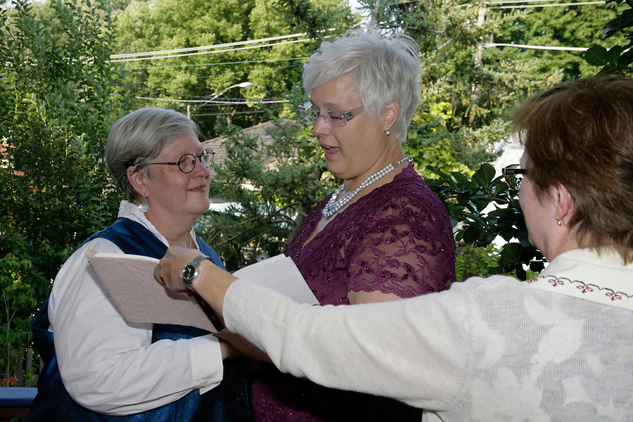 Loved ones celebrated the 20+ marriage of Cheryl Haugh and Elizabeth Ritzman at an evening garden party at Dominican University on August 2, 2014. There were a ceremony, dressed up children, singing, dancing, food, spirits, infused waters and cake. [Photo by Karen Kring]