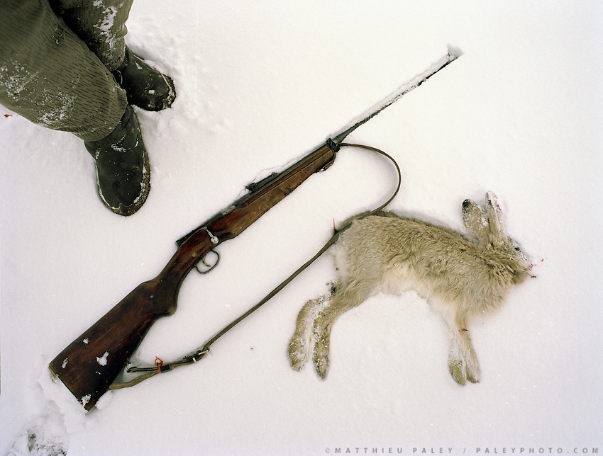 Toshi Boi hunts rabbit (although its considered Haram) to compliment his meagre winter diet. .Winter expedition through the Wakhan Corridor and into the Afghan Pamir mountains, to document the life of the Afghan Kyrgyz tribe. January/February 2008. Afghanistan