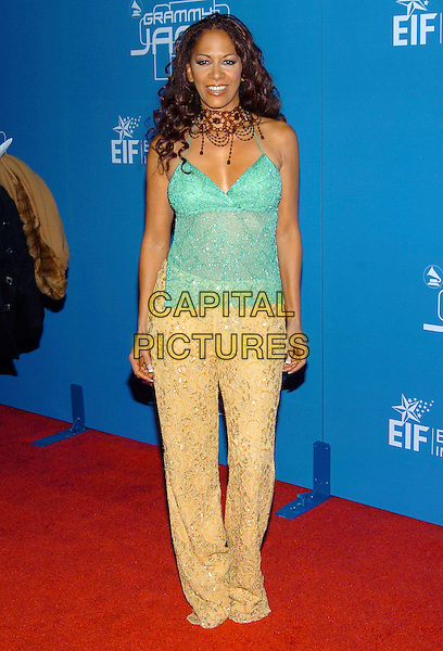 SHEILA E..2004  Grammy Jam Celebration of the music of Earth, Wind and Fire held at the Wiltern LG Theatre, Los Angeles, California , USA, 11th December 2004 .full length green top beige trousers.Ref: ADM.www.capitalpictures.com.sales@capitalpictures.com.©Laura Farr/AdMedia/Capital Pictures .