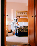 TURKEY, Istanbul, a room attendant in a bedroom at the Four Seasons Hotel