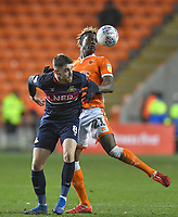 Blackpool's Armand Gnanduillet battles with Doncaster Rovers' Ben Whiteman<br /> <br /> Photographer Dave Howarth/CameraSport<br /> <br /> The EFL Sky Bet League One - Blackpool v Doncaster Rovers - Tuesday 12th March 2019 - Bloomfield Road - Blackpool<br /> <br /> World Copyright © 2019 CameraSport. All rights reserved. 43 Linden Ave. Countesthorpe. Leicester. England. LE8 5PG - Tel: +44 (0) 116 277 4147 - admin@camerasport.com - www.camerasport.com