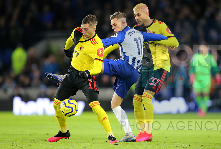 Brighton's Leandro Trossard is challenged by Watford's Gerard Deulofeu and Roberto Pereyra during the Premier League match at the American Express Community Stadium, Brighton and Hove. Picture date: 8th February 2020. Picture credit should read: Paul Terry/Sportimage