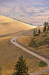 A car on the winding gravel road through the National Bison range near Moiese, Montana