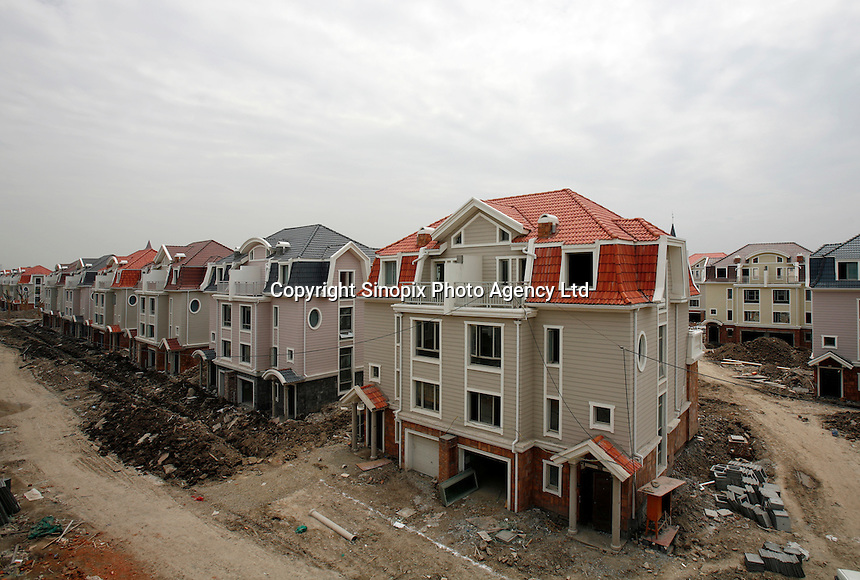 A view of a housing development still under construction at the Luodian New Town in Shanghai, China. Designed by the Swedish firm SWECO group, Luodian takes its architectural style from Scandinavia and is one of the nine satellite towns currently planned by the Shanghai government..16 May 2006