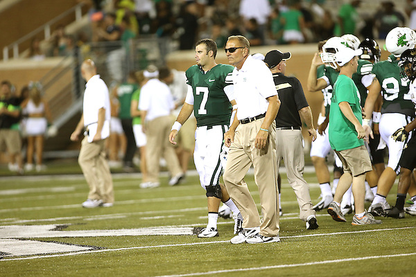 DENTON, TX - AUGUST 31: North Texas Mean Green head coach Dan McCarney of the North Texas  and quarterback Derek Thompson (7) - Mean Green Football vs Idaho Vandals at Apogee Stadium in Denton on August 31, 2013 in Denton, Texas. Photo by Rick Yeatts