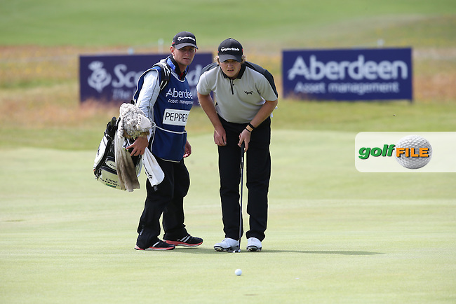 Eddie Pepperell (ENG) putting out on the 16th  for par during Round Three of the 2015 Aberdeen Asset Management Scottish Open, played at Gullane Golf Club, Gullane, East Lothian, Scotland. /11/07/2015/. Picture: Golffile | David Lloyd<br /> <br /> All photos usage must carry mandatory copyright credit (&copy; Golffile | David Lloyd)