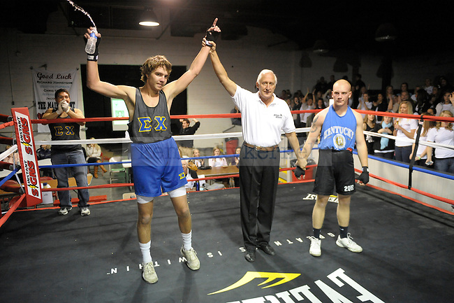 Adam Shipley (left) of Sigma Chi fought Warren Wenzel (right) of Delta Tau Delta at the Sigma Chi Fraternity & Alpha Delta Pi Sorority sponsored The Main Event 2011 in Lexington, Ky. Adam Shipley won the fight by decision. Photo by Mike Weaver |