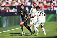 Landover, MD - August 4, 2018: Juventus midfielder Claudio Marchisio (8) dribbles around Real Madrid midfielder Franchu Feuillassier (29) during the match between Juventus and Real Madrid at FedEx Field in Landover, MD.   (Photo by Phillip Peters/Media Images International)