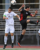 Robert Cerrito #4 of Whitman, left, heads a ball away from Sam Steinberg #10 of Half Hollow Hills East during the first half of a Suffolk County League II varsity boys soccer game at Whitman High School on Monday, Sept. 19, 2016. Hills East won by a score of 2-1.