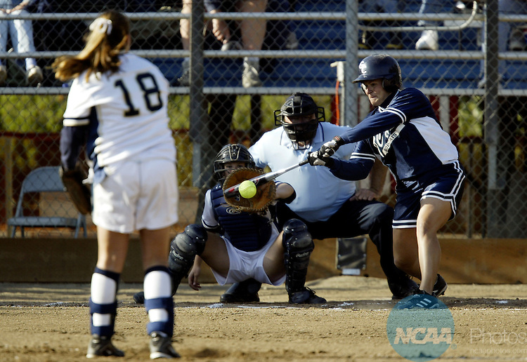 18 MAY 2003:  Pitcher Amy Rosson (18) of UC Davis gets centerfielder Joni Frei (14) of Georgia College & State University to groundout during the Division 2 Women's Softball Championship held at the Wallace Sports Complex in Salem, OR.  UC Davis defeated Georgia College 7-0 for the national title.  Jamie Schwaberow/NCAA Photos