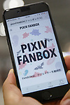 A smartphone shows a Pixiv Fanbox app during the Comic Market 94 (Comiket) event at Tokyo Big Sight on August 11, 2018, Tokyo, Japan. The annual event that began in 1975 focuses on manga, anime, game and cosplay. Organizers expect more than 500,000 visitors to attend the 3-day event. (Photo by Rodrigo Reyes Marin/AFLO)