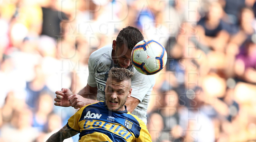 Calcio, Serie A: Inter Milano-Parma, Giuseppe Meazza stadium, September 15, 2018.<br /> Inter's Danilo D'ambrosio (top) in action with Parma's Federico Dimarco during the Italian Serie A football match between Inter and Parma at Giuseppe Meazza (San Siro) stadium, September 15, 2018.<br /> UPDATE IMAGES PRESS/Isabella Bonotto