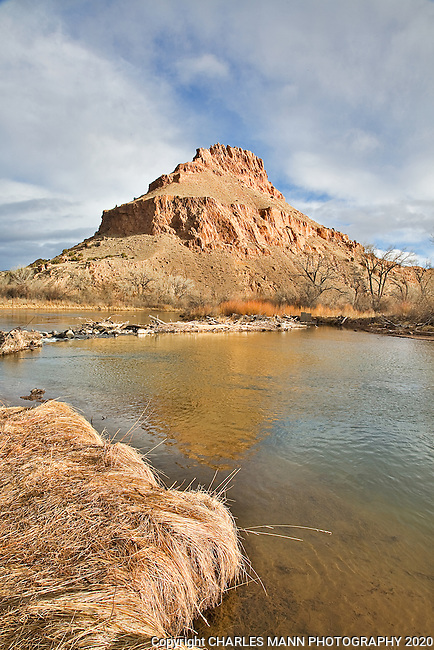 The Chama River flows beneath rugged cliffs of colored earth near the village of Abuiquiu in northern New Mexico, not far from the home of Georgia O'Keefe.