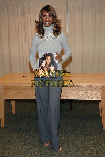 """IMAN.Signs copies of her new book, """"The Beauty Of Color"""" at the Barnes & Noble Bookstore on 5th Avenue in Manhattan, New York, New York. .October 17th, 2005.Photo Credit: Patti Ouderkirk/AdMedia/Capital Pictures.Ref: PO/ADM.full length grey gray trousers sweater turtleneck polo neck.www.capitalpictures.com.sales@capitalpictures.com.© Capital Pictures."""