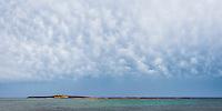 Panoramic photo of Capo Passero Island (Isola di Passero) at Portopalo di Capo Passero, the South Eastern most tip of Sicily, Italy, Europe. This is a panoramic photo of Capo Passero Island (Isola di Passero) at Portopalo di Capo Passero, the South Eastern most tip of Sicily, Italy, Europe.