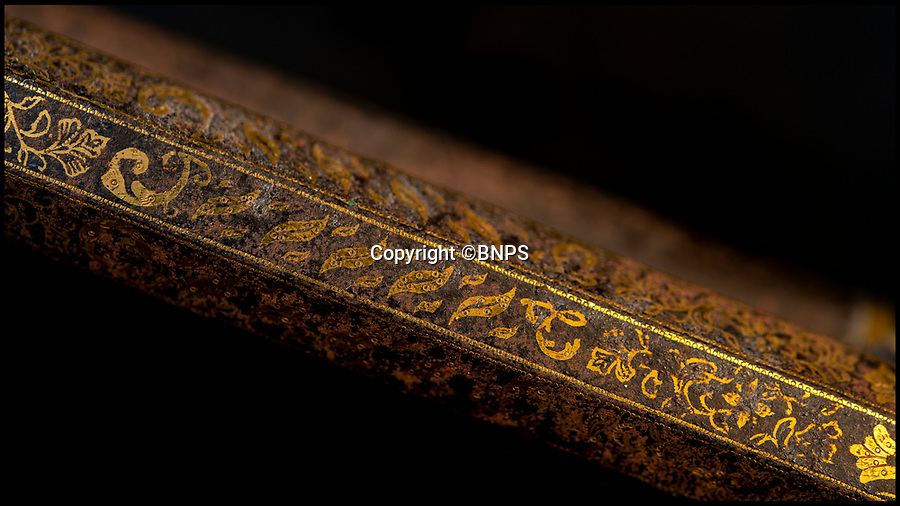 BNPS.co.uk (01202) 558833<br /> Pic: PhilYeomans/BNPS<br /> <br /> The stylised tiger stripes in gold on the muskets barrel alerted auctioneer Anthong Cribb to the weapons historic status.<br /> <br /> Stunning artefacts from Indian hero Tipu Sultan's fateful last stand have been rediscovered by the family of an East India Company Major who took part in the famous battle that ended his reign.<br /> <br /> And now Major Thomas Hart's lucky descendents are likely to become overnight millionaires after retrieving the historic items from their dusty attic.<br /> <br /> The fascinating treasures were taken from Tipu's captured fortress of Seringapatam in the wake of his defeat by British forces led by a young Duke of Wellington in 1799.<br /> <br /> The cache of ornate gold arms and personal effects even include's the battle damaged musket the Sultan used in his fatal last stand against the expanding British Empire in India.<br /> <br /> Tipu was last seen on the battlements of the fortress firing his hunting musket at the advancing British and after the fierce encounter his body was found bearing many wounds, including a musket ball shot above his right eye.<br /> <br /> The rediscovered musket, complete with battle damaged bayonet, has the distinctive tiger stripe pattern unique to the self styled Tiger of Mysore own weapons - and tellingly there is also shot damage to the lock and stock that may have been caused by the musket ball that finished him off.<br /> <br /> Also included in the sale are four ornate gold-encrusted sword's bearing the mark of Haider Ali Khan, Tipu's father and the previous ruler of independent Mysore, along with a solid gold 'betel casket' complete with three 220 year old nuts still inside.<br /> <br /> The war booty was brought back to Britain by Major Thomas Hart of the British East India Company following the fourth and final Anglo-Mysore war.<br /> <br /> They have been passed down through the family ever since and now belong to a couple wh