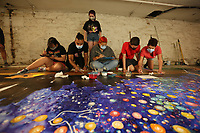 Farmington High School and Junior High School students in Gretchen Wilkes' art class paint Thursday, July 30, 2020, on an 8 foot by 24 foot mural in the Down Under at Fenix Gallery on the downtown square in Fayetteville. Students in Wilkes' Farmington Junior High School art class partnered with local artist Octavio Logo to create the mural that will be displayed Saturday, August 22, in Farmington on the side of a building near Hwy. 62. Check out nwaonline.com/200731Daily/ and nwadg.com/photos for a photo gallery.<br /> (NWA Democrat-Gazette/David Gottschalk) <br /> <br /> FZ FEA MURAL 7-31