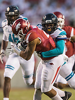 Hawgs Illustrated/BEN GOFF <br /> Dontay Hears (2), Coastal Carolina cornerback, tackles Devwah Whaley, Arkansas running back, in the fourth quarter Saturday, Nov. 4, 2017, at Reynolds Razorback Stadium in Fayetteville.