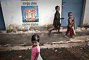 Children are seen outside the abandoned migration apartments at the Sansilo rehabilitation colony, set up by the TATA Steel company for the displaced families in Kalinganagar, Orissa, India.