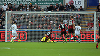 Joshua King of Bournemouth (17) scores the opening goal for his team, Lukasz Fabianski of Swansea fails to catch the ball during the Barclays Premier League match between Swansea City and Bournemouth at the Liberty Stadium, Swansea on November 21 2015