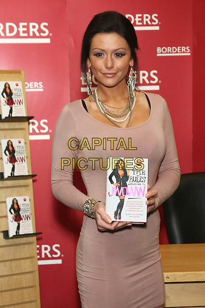 JENNI FARLEY (JWoww).'The Rules According to JWoww' book signing at Borders Columbus Circle, New York, USA, 9th February 2011..half length beige brown dress  holding book .CAP/LNC/TOM.©LNC/Capital Pictures.