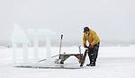 Snowking harvesting ice