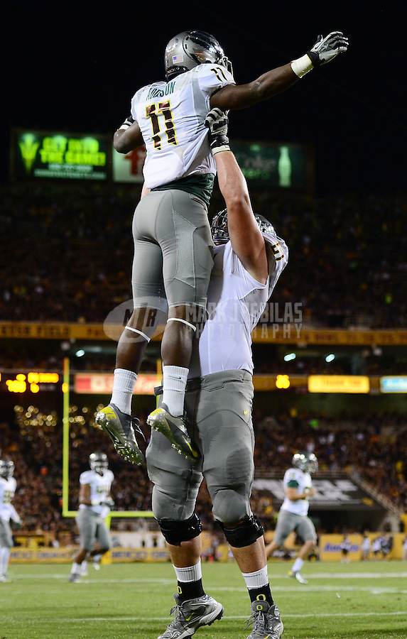 Oct. 18, 2012; Tempe, AZ, USA; Oregon Ducks wide receiver (11) Bralon Addison celebrates a touchdown with a teammate against the Arizona State Sun Devils in the first quarter at Sun Devil Stadium. Mandatory Credit: Mark J. Rebilas-