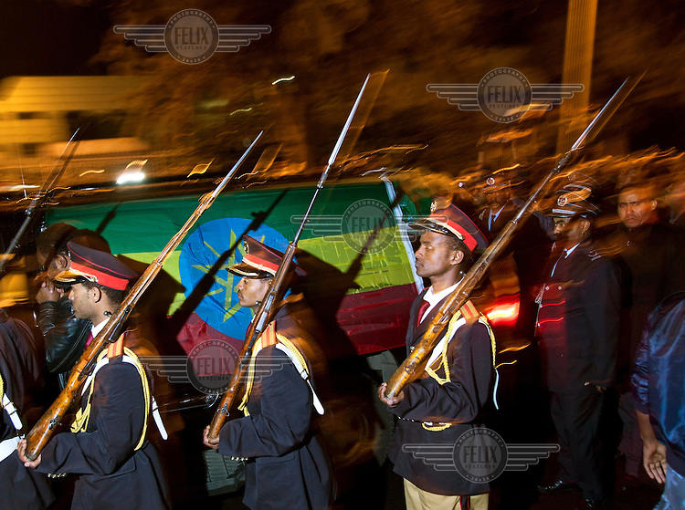 Members of the military march as the mortal remains of Prime Minister Meles Zenawi arrives at Bole International Airport in Addis Ababa. Prime Minister Meles Zenawi died on August 20. He had been in power since 1991.