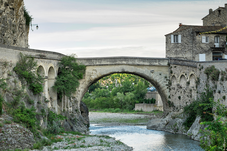 The roman bridge, built 2000 years ago, still separates the Old & New Towns in Vaison la Romaine in Provence.