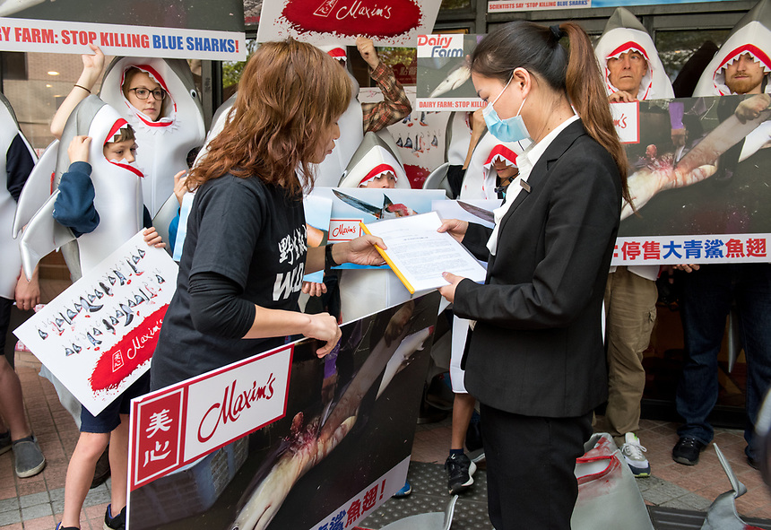 HONG KONG SAR: CHINA - February 10,2018.  Wildlife activists, WildAid, stage a protest at Maxims restaurant in Hong Kong University over their continued sale of shark fin soup. The Maxim group of restaurants across Hong Kong will continue to serve the soup in large quantities with it featuring on their Chinese New Year banquets. Protesters present the manager of the outlet a letter signed by over 250 scientists, local and international marine conservationists, animal welfare groups and concerned citizens including Sir Richard Branson, Dr Jan Goodall, Dr Boris Worm and Dr Daniel Pauly.