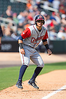 Rio Ruiz (24) of the Gwinnett Braves takes his lead off of third base against the Charlotte Knights at BB&T BallPark on May 22, 2016 in Charlotte, North Carolina.  The Knights defeated the Braves 9-8 in 11 innings.  (Brian Westerholt/Four Seam Images)