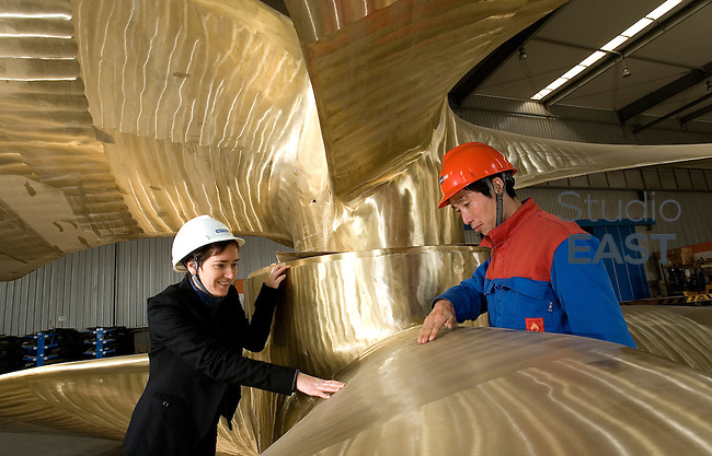 Wartsila CME worker Liu Baocheng (right) and Wartsila CME general manager Tamara de Gruyter (left) chat while inspecting two giant propellers, in Wartsila CME factory in Zhenjiang, Jiangsu province, China, on January 14, 2010. Photo by Lucas Schifres/Pictobank