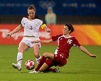 USWNT captain (3) Christie Rampone is tackled by Canadian midfielder (16) Jonelle Filigno while playing at Shanghai Stadium.  The US defeated Canada, 2-1, in extra time and advanced to the semifinals during the 2008 Beijing Olympics in Shanghai, China.