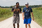 August 14, 2017;  On Day 1 of the ND Trail, pilgrims JesusLord Nwadiuko and Matt Blazejewski (right) make the 19 mile trek from Vincennes to the Morris Chapel in Oaktown, Indiana. As part of the University's 175th anniversary celebration, the Notre Dame Trail will commemorate Father Sorin and the Holy Cross Brothers' journey. A small group of pilgrims will make the entire 300+ mile journey from Vincennes to Notre Dame over  two weeks. (Photo by Barbara Johnston/University of Notre Dame)