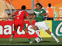 JUNE 11, 2006: Nuremberg, Germany: Mexican forward (9) Jose Fonseca tries to get around Iranian defender (5) Rahman Rezaei during the World Cup Finals at Franken-Stadion in Nuremberg, Germany.  Mexico defeated Iran, 3-1.