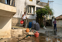Local residents fill up their pitchers with municipal water in a neighbourhood in Medak, Telangana, India.