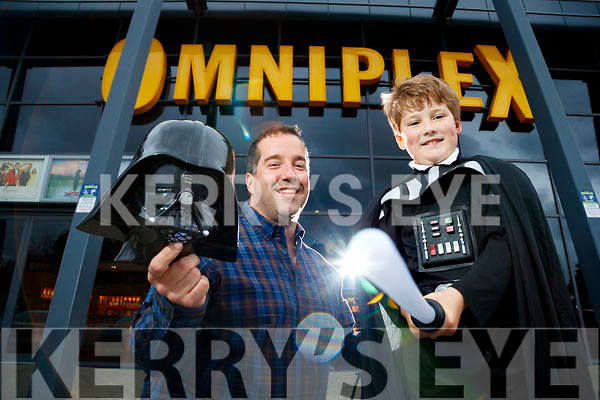 """Graham Kelliher Banna with his son Kai booking their tickets for the new Star Wars Movie """"The Last Jedi"""" which opens in December."""