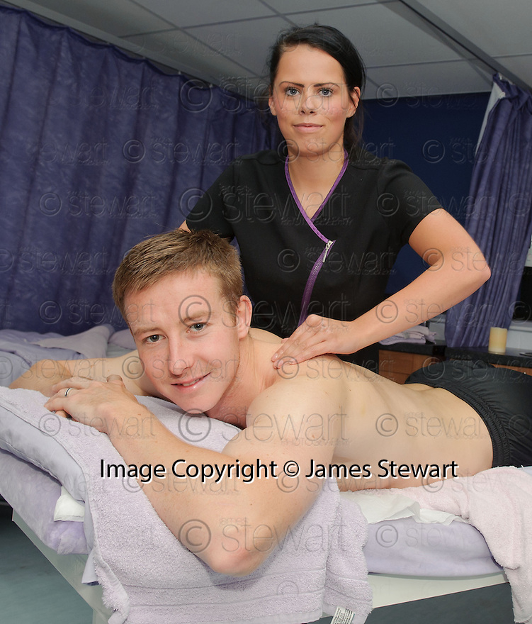 Queen of the South captain Chris Higgins receives a back massage from Julie Newall from Cumbernauld College as a treat for putting Rangers out of the Ramsden Cup ...