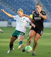 Red Stars defender Natalie Spilger (13) attempts to win the ball from FC Gold Pride midfielder Kiki Bosio (11).  The FC Gold Pride defeated the Chicago Red Stars 3-2 at Toyota Park in Bridgeview, IL on August 22, 2010