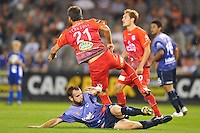 MELBOURNE, AUSTRALIA - JANUARY 23, 2010: Grant Brebner from Melbourne Victory tackles Mark Rudan from Adelaide United in round 24 of the A-league match between Melbourne Victory and Adelaide United FC at Etihad Stadium on January 23, 2010 in Melbourne, Australia. Photo Sydney Low www.syd-low.com