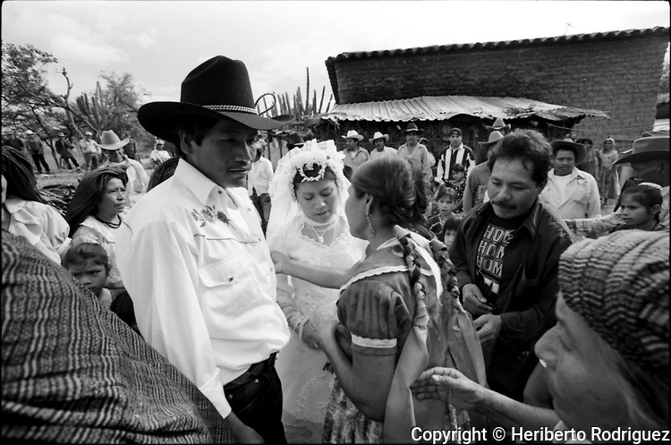A fiancee is hugged by her relatives as she arrives at her husband's house in Coatecas Altas village, Oaxaca, November 22, 1998. Most of the villagers of Coatecas leave their home to harvest in northern state of Sinaloa.  © Photo by Heriberto Rodriguez